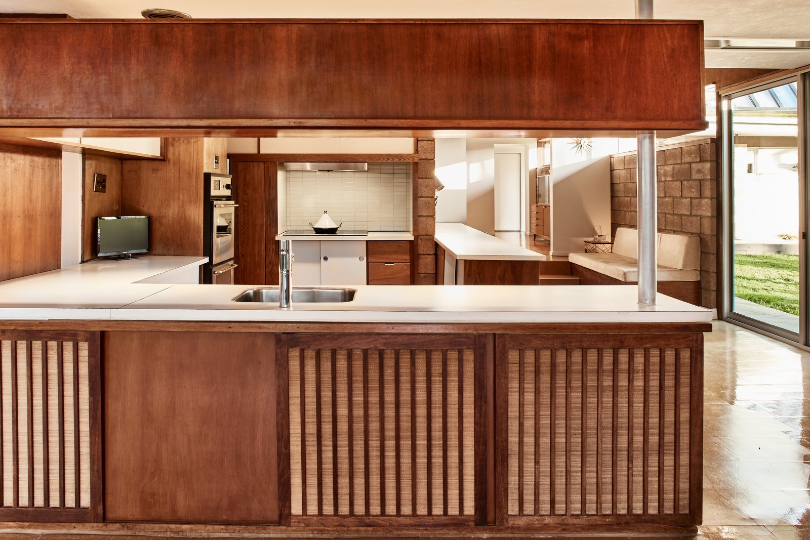 Tagged: Kitchen and Wood Cabinet.  Photo 6 of 13 in The Stunningly Restored Hassrick Residence by Richard Neutra Hits the Market at $2.2M