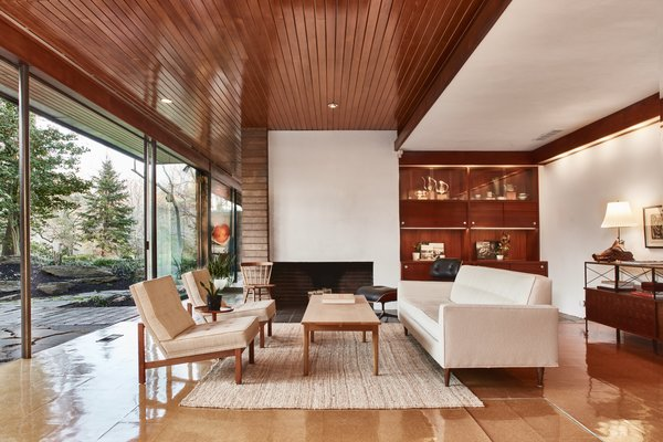 Modern home with living room, chair, sofa, recessed lighting, and standard layout fireplace. Photo 2 of Hassrick Residence