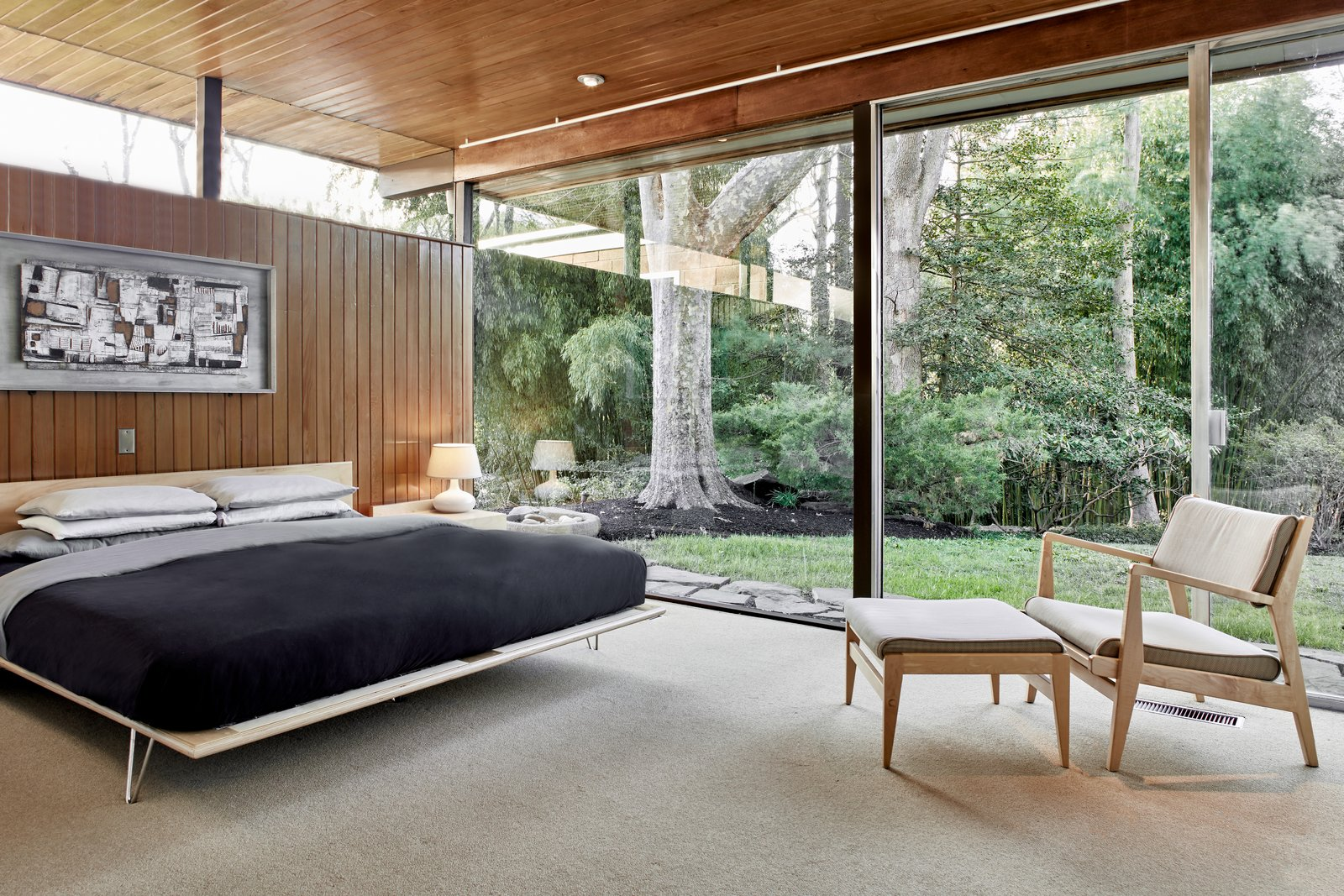Tagged: Bedroom, Bed, Carpet Floor, Chair, and Ceiling Lighting.  Photo 11 of 13 in The Stunningly Restored Hassrick Residence by Richard Neutra Hits the Market at $2.2M