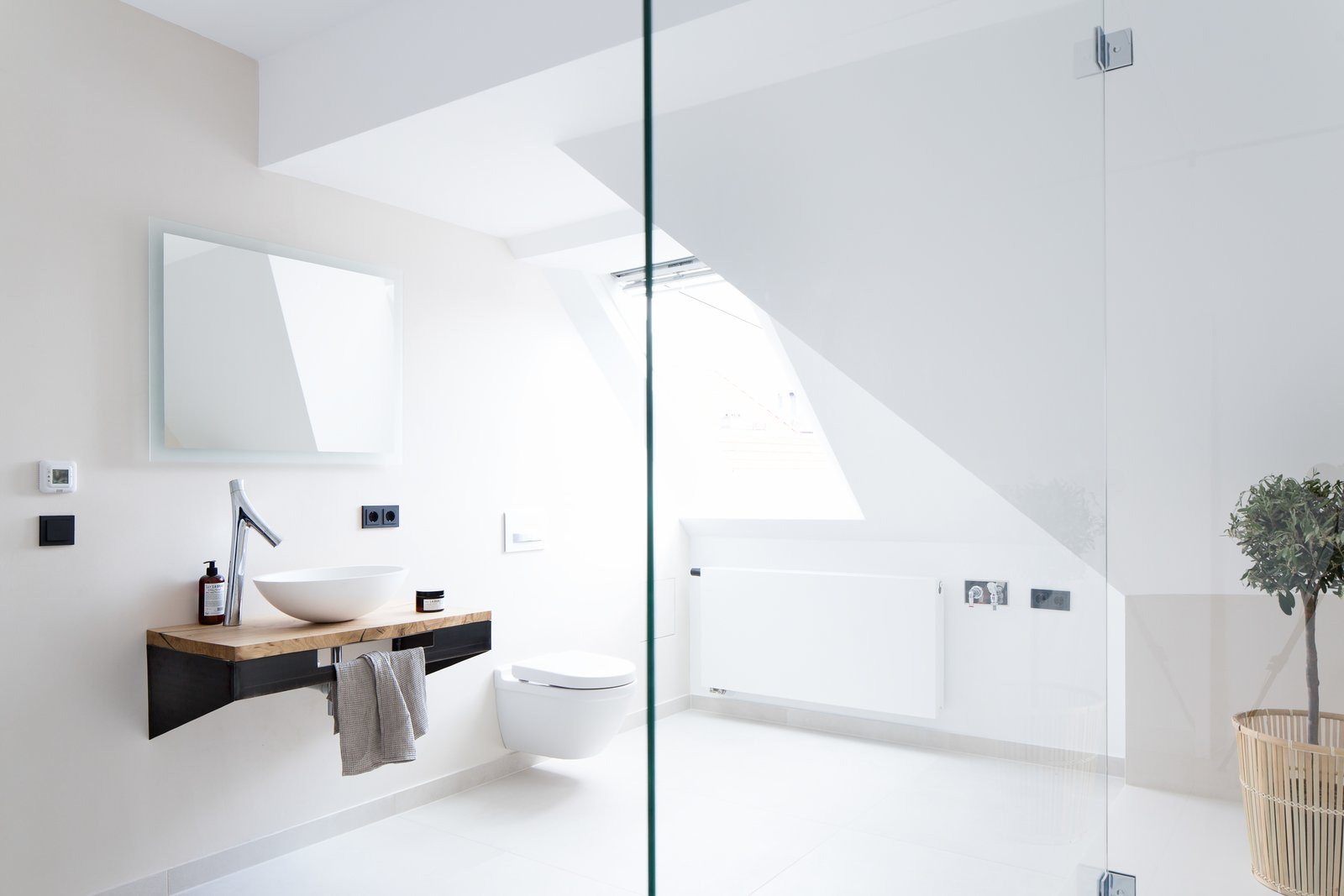 Tagged: Bed, Table, Chair, Freestanding Tub, Open Shower, Mosaic Tile Wall, Medium Hardwood Floor, and Bath Room. This Modern Loft For Sale Will Have You Dreaming of Berlin - Photo 11 of 13