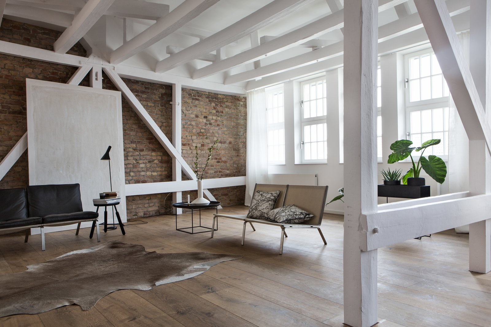 Tagged: Medium Hardwood Floor, End Tables, Floor Lighting, Sofa, and Living Room.  Photo 2 of 13 in This Modern Loft For Sale Will Have You Dreaming of Berlin
