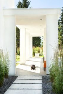 An open-air entry pavilion contributes to a sense of arrival at the home.