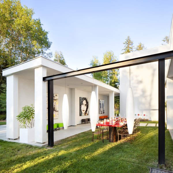 Modern home with outdoor, trees, front yard, grass, and small patio, porch, deck. The outdoor dining Photo 3 of 534 Twin Bridges Road