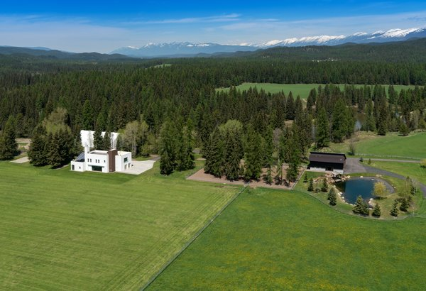 Modern home with outdoor, trees, woodland, grass, and back yard. With easy access to the Whitefish Mountain Resort and Glacier National Park, the home offers plenty to explore—on the grounds and off. Photo 11 of 534 Twin Bridges Road
