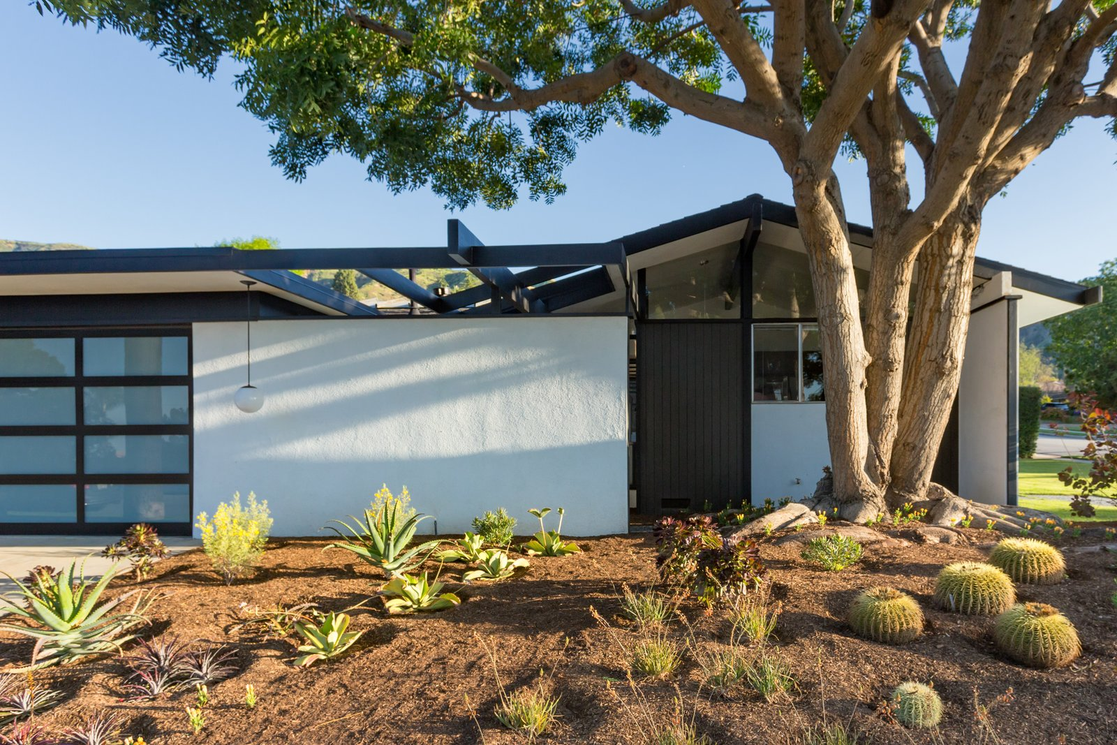 Tagged: Outdoor, Front Yard, and Trees.  Photo 2 of 14 in Offered at $899K, a Restored Midcentury Abode Shines in Southern California