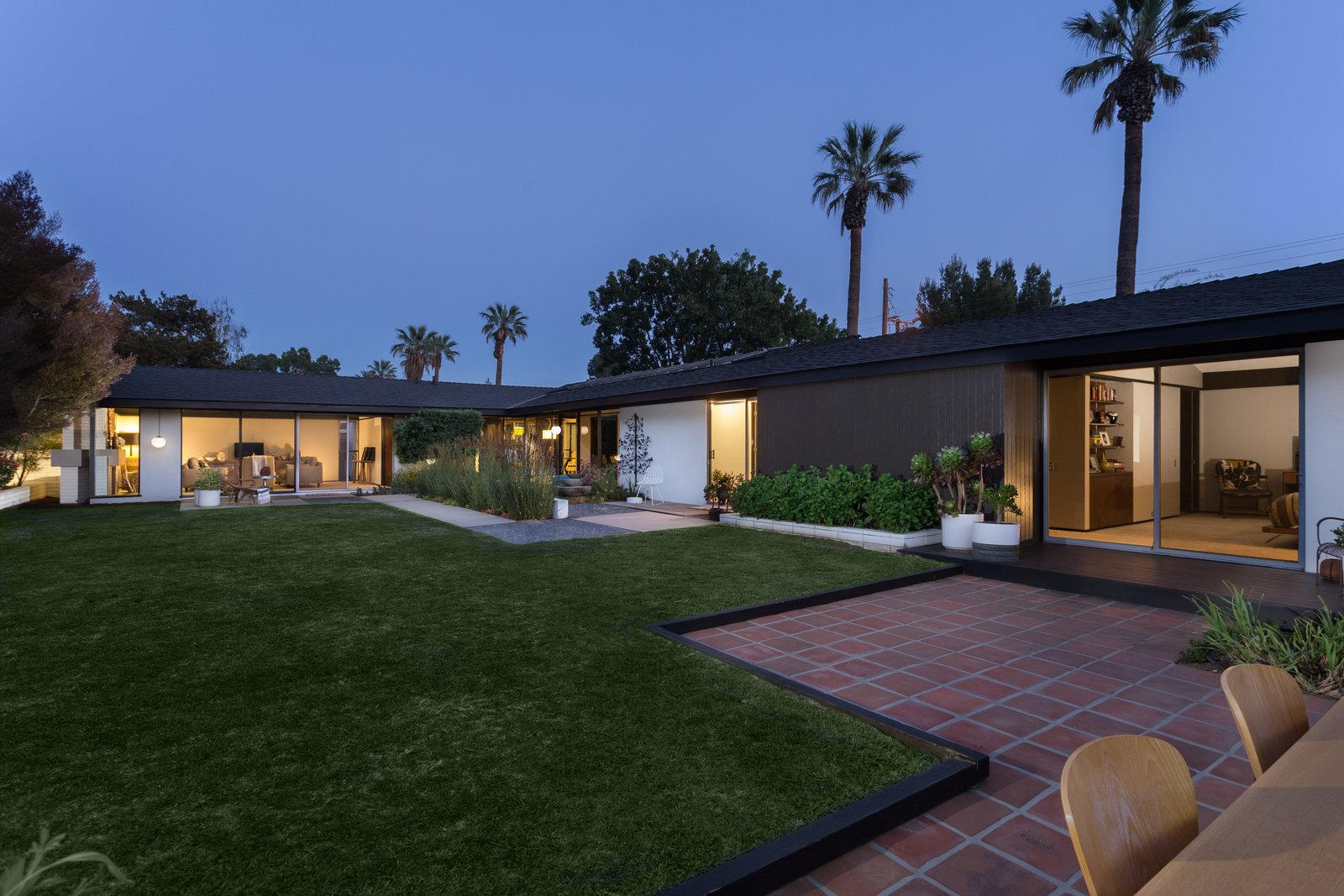 Tagged: Outdoor, Back Yard, and Grass.  Photo 14 of 14 in Offered at $899K, a Restored Midcentury Abode Shines in Southern California