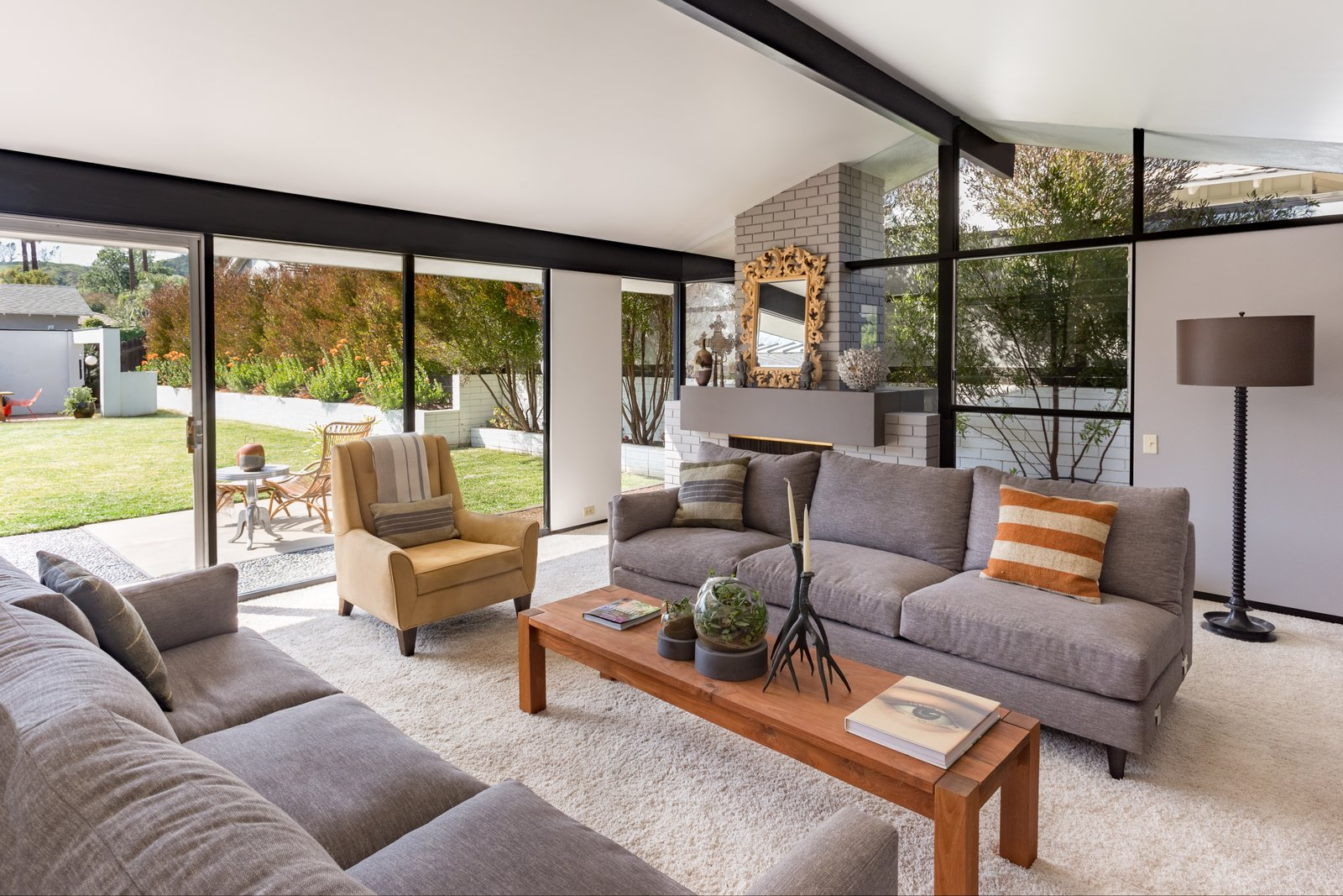 Tagged: Living Room, Sofa, Chair, Coffee Tables, Floor Lighting, and Standard Layout Fireplace.  Photo 5 of 14 in Offered at $899K, a Restored Midcentury Abode Shines in Southern California