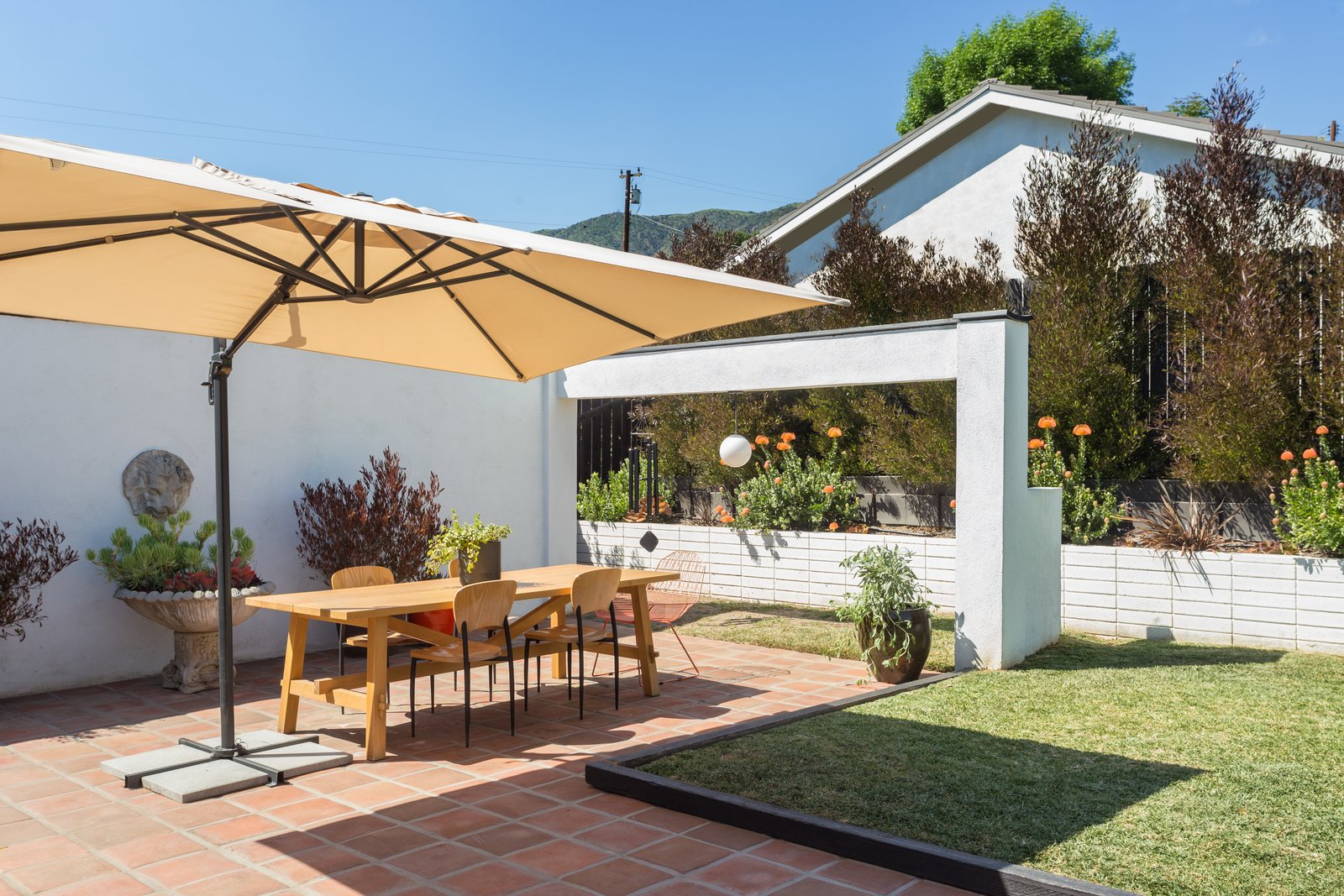 Tagged: Outdoor, Back Yard, Grass, and Small Patio, Porch, Deck.  Photo 12 of 14 in Offered at $899K, a Restored Midcentury Abode Shines in Southern California