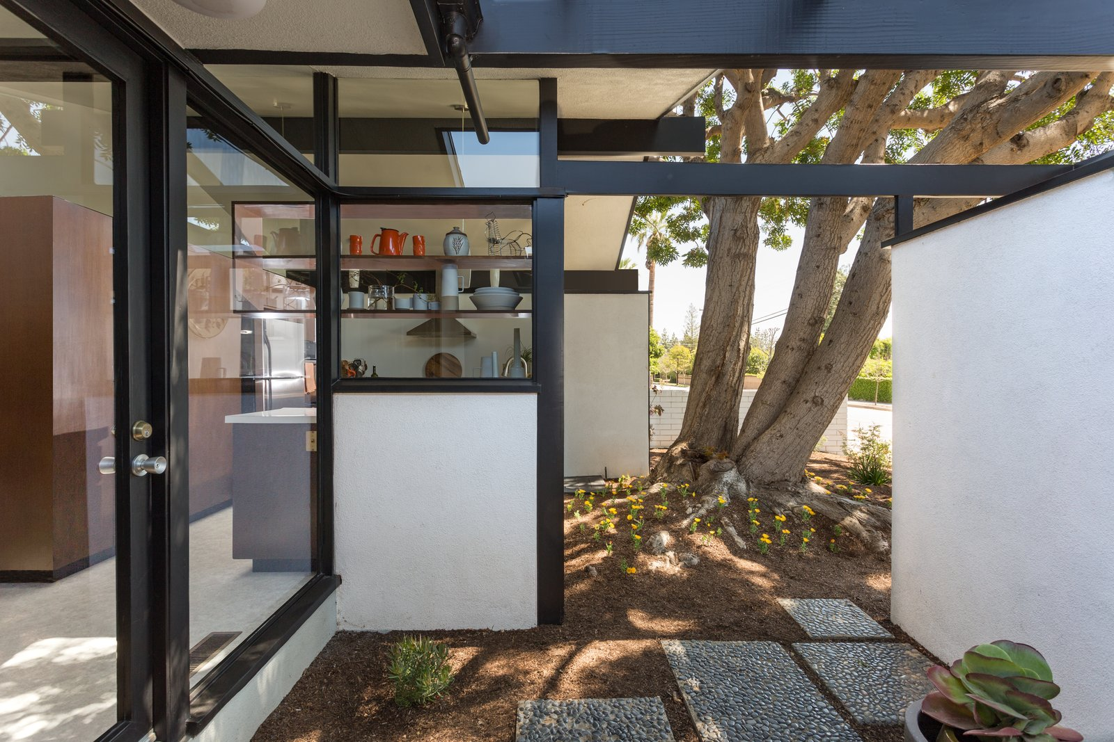 Tagged: Outdoor and Small Patio, Porch, Deck.  Photo 7 of 14 in Offered at $899K, a Restored Midcentury Abode Shines in Southern California