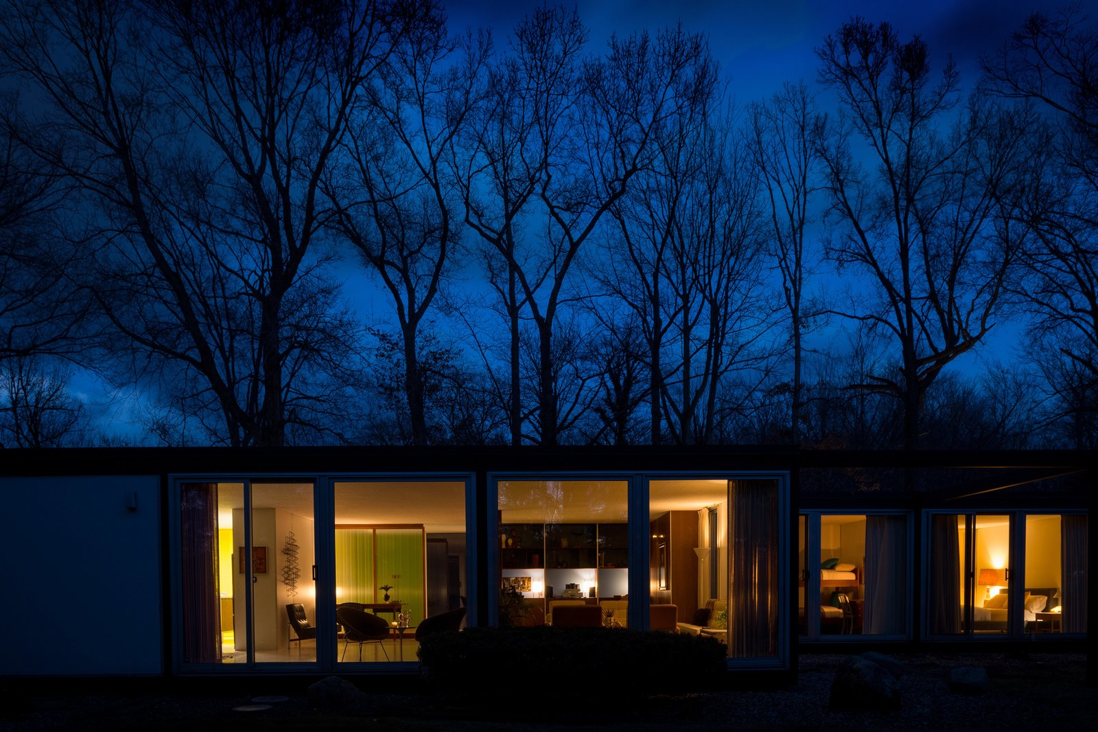 Generous stretches of glass allow the house to glow at night.  Photo 14 of 14 in A Rare Midcentury Prefab Looks Just Like it Did in 1958—Down to the Knoll and Paul McCobb Interiors