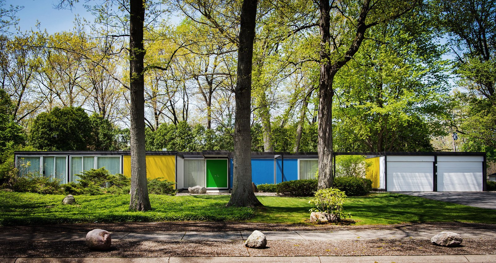 Built with a steel frame, the Frost House features panels of styrofoam between aluminum sheets for the exterior walls and styrofoam between plywood for the roof and floors. Bold, primary colors accentuate its geometric form.   Shortly after Karen Valentine and Bob Coscarelli purchased the home in 2016, they began to unearth nuggets of information about its pedigree. Their realtor had provided a brochure that identified the prefab as designed by architect Emil Tessin for the now-defunct Alside Homes Corporation based out of Akron, Ohio, which had held a patent for the structure's aluminum paneling. Their new neighbors provided a stack of Alside Homes sales materials, floor plans of various models, and even a script that had been written for salespeople during home tours. They determined that the Frost House had been a sales model for the company, and that Tessin had been the son of Emil Albert Tessin, the legal guardian of Florence Knoll. Tagged: Exterior, House, Flat RoofLine, and Prefab Building Type.  Photo 10 of 10 in Dwell's Top 10 Prefabs of 2017 from A Rare Midcentury Prefab Looks Just Like it Did in 1958—Down to the Knoll and Paul McCobb Interiors