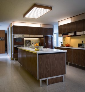 Paul McCobb designed the kitchen, built-in shelving units, and vanities throughout the abode. All the original General Electric appliances are in working order.
