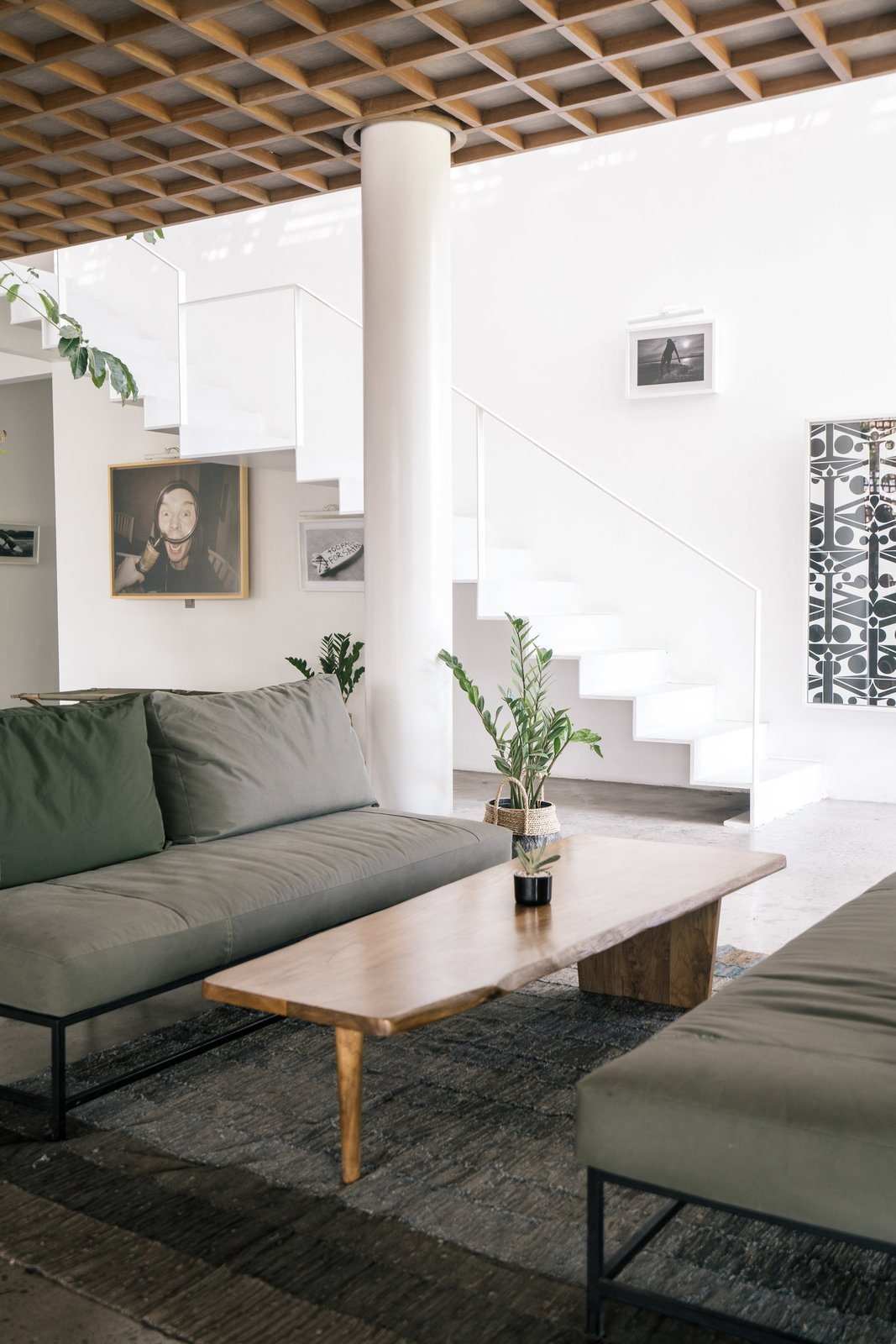 The Slow's slogan is Tagged: Living Room, Concrete Floor, Rug Floor, Coffee Tables, and Sofa.  Photo 4 of 12 in Go Beyond the Basics in an Australian Fashion Designer's Surf-Inspired Bali Hotel