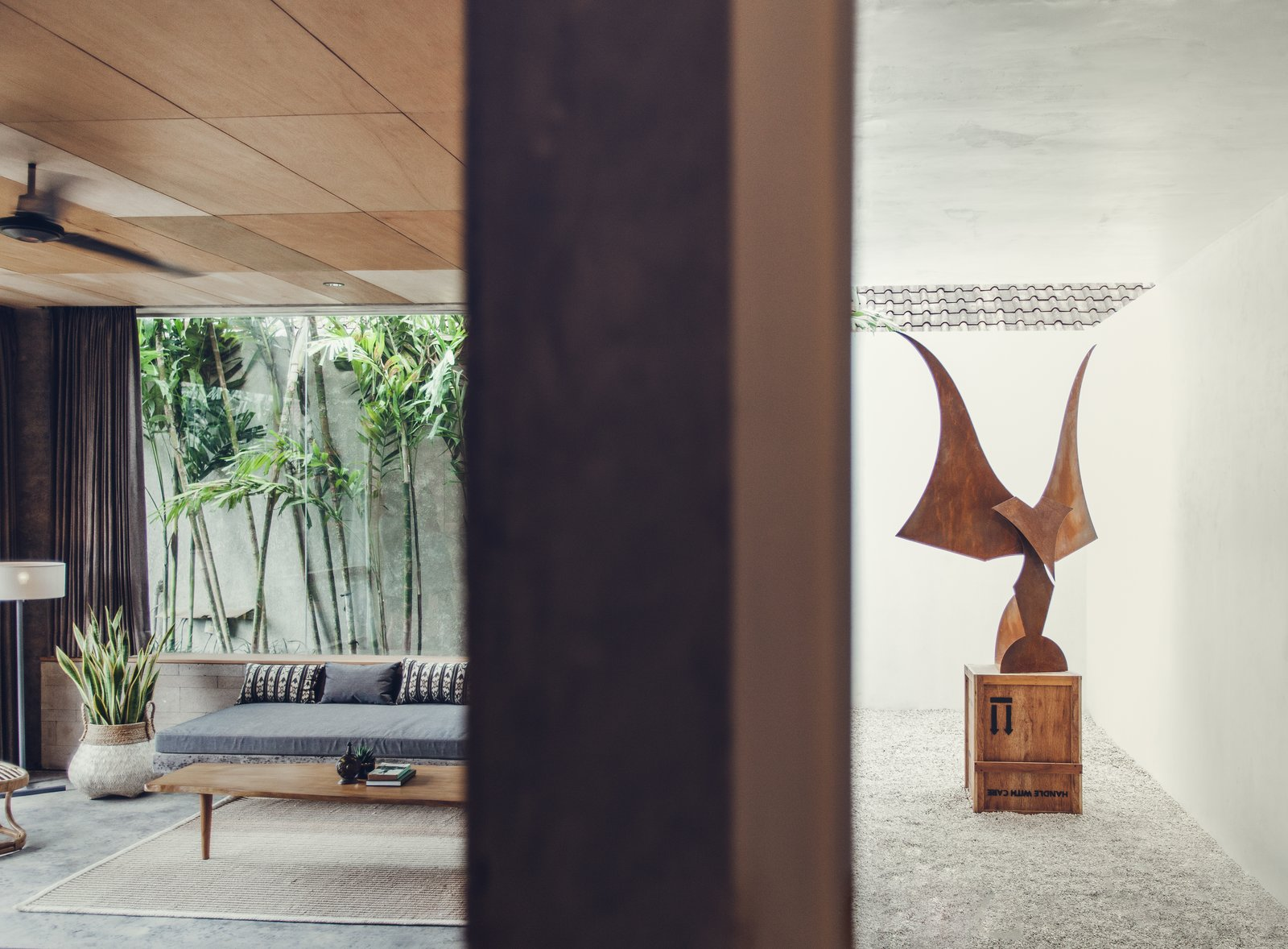 Garuda of Death Metal by Madsaki is a featured piece. Tagged: Living Room, Floor Lighting, Bench, Coffee Tables, Concrete Floor, Rug Floor, Lamps, and Recessed Lighting.  Photo 8 of 12 in Go Beyond the Basics in an Australian Fashion Designer's Surf-Inspired Bali Hotel