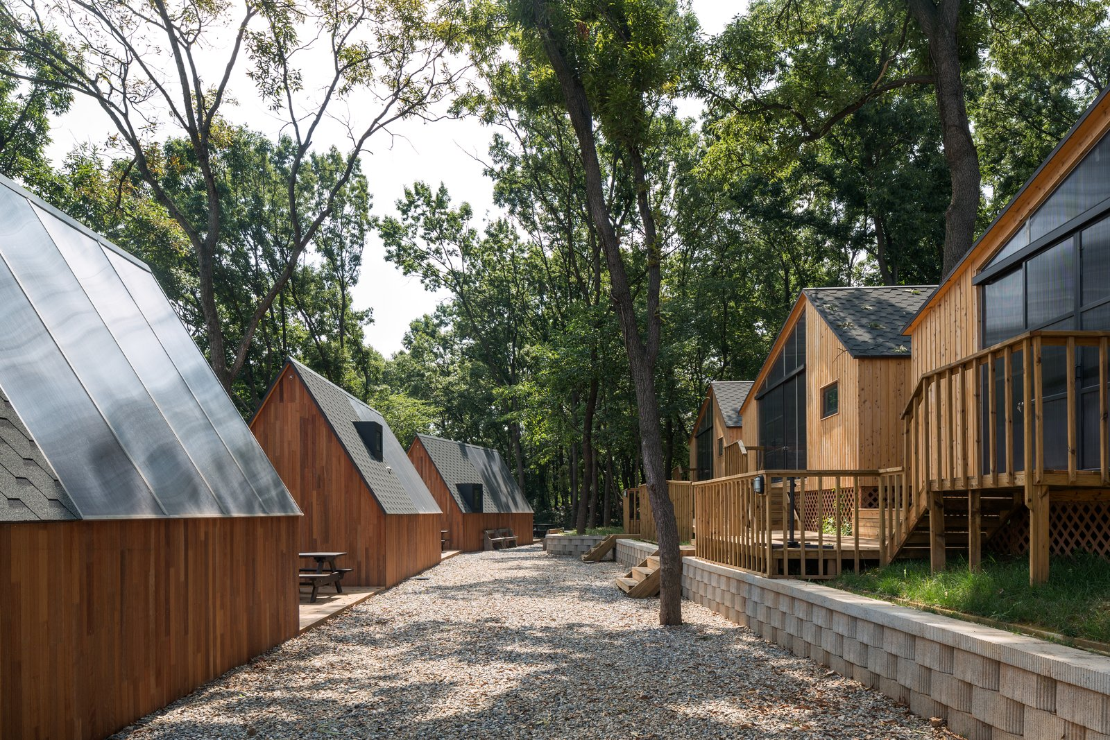 Tagged: Exterior, Cabin Building Type, Shed Building Type, Gable RoofLine, and Wood Siding Material.  Photo 7 of 11 in A Camping Village in South Korea Draws Inspiration From an Iconic Fairy Tale