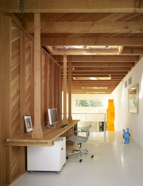 Modern home with office, study, chair, and desk. Photo 8 of Norwich Drive Residence