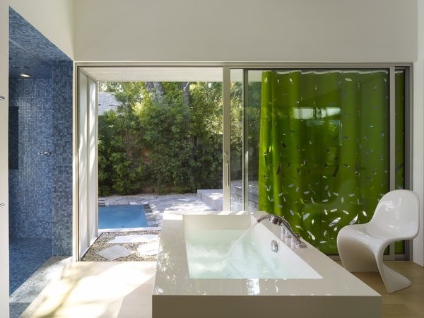 Modern home with bath room, freestanding tub, and open shower. Photo 6 of Norwich Drive Residence