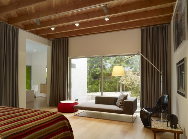 Modern home with bedroom, chair, bed, floor lighting, and light hardwood floor. Photo 5 of Norwich Drive Residence