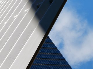 "Nikola Olic's Dizzying Architectural Photography - Photo 16 of 16 - Ground Zero Balance: ""Massive white wings of Santiago Calatrava's Oculus structure play a part in the somber balance of light and shadow, sky and structure, old and new, heavy and light, at the Ground Zero memorial in NYC."""