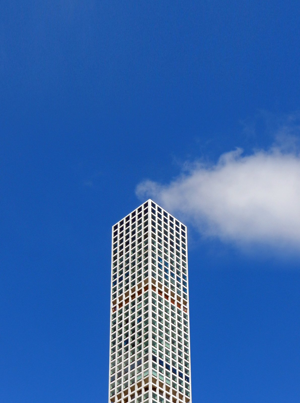 The Smoking Building. A well-placed cloud gives the impression that this New York City building is emitting steam, a visual metaphor for the hot real estate market.  Photo 15 of 16 in Nikola Olic's Dizzying Architectural Photography