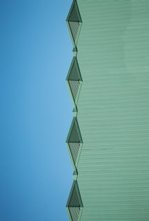 "Nikola Olic's Dizzying Architectural Photography - Photo 8 of 16 - The Blue Green Mile. ""Warmed by the unobstructed afternoon sun, individual parts of the large Art Deco collection at the Fair Park Complex in South Dallas come to more attention,"" says Olic."