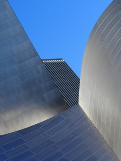 "Nikola Olic's Dizzying Architectural Photography - Photo 9 of 16 - Disney and Neighbor. ""So much happening in a single city block,"" notes Olic. ""Reflective, disorienting, dimensionless, otherworldly Frank Gehry's Walt Disney Hall, which hosts the Los Angeles Philharmonic, conducted by Gustavo Dudamel."""