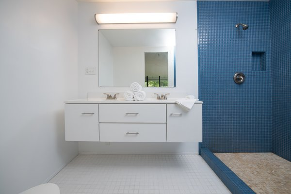 Modern home with bath room, open shower, mosaic tile wall, and wall mount sink. Photo 9 of Hanselmann House