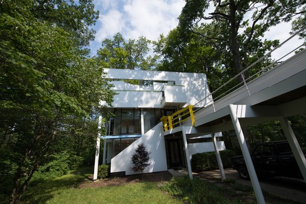 Modern home with outdoor, grass, front yard, and trees. Photo  of Hanselmann House