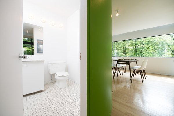 Modern home with bath room, ceramic tile floor, wall lighting, and two piece toilet. Photo 5 of Hanselmann House