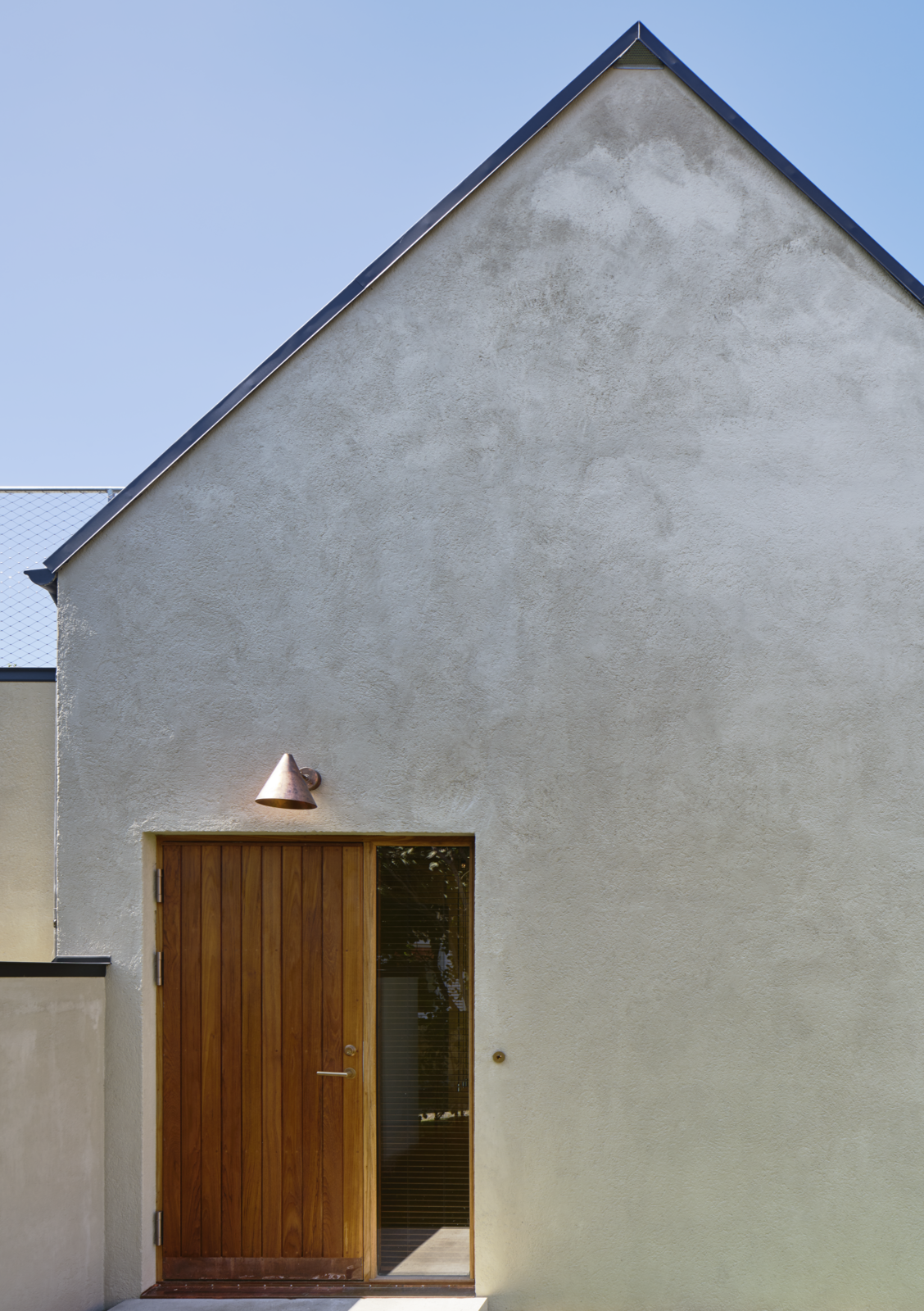 Tagged: Doors, Wood, and Exterior.  Photo 2 of 12 in Sleek Scandinavian Design Permeates a Family's Summer House in an Old Fishing Village
