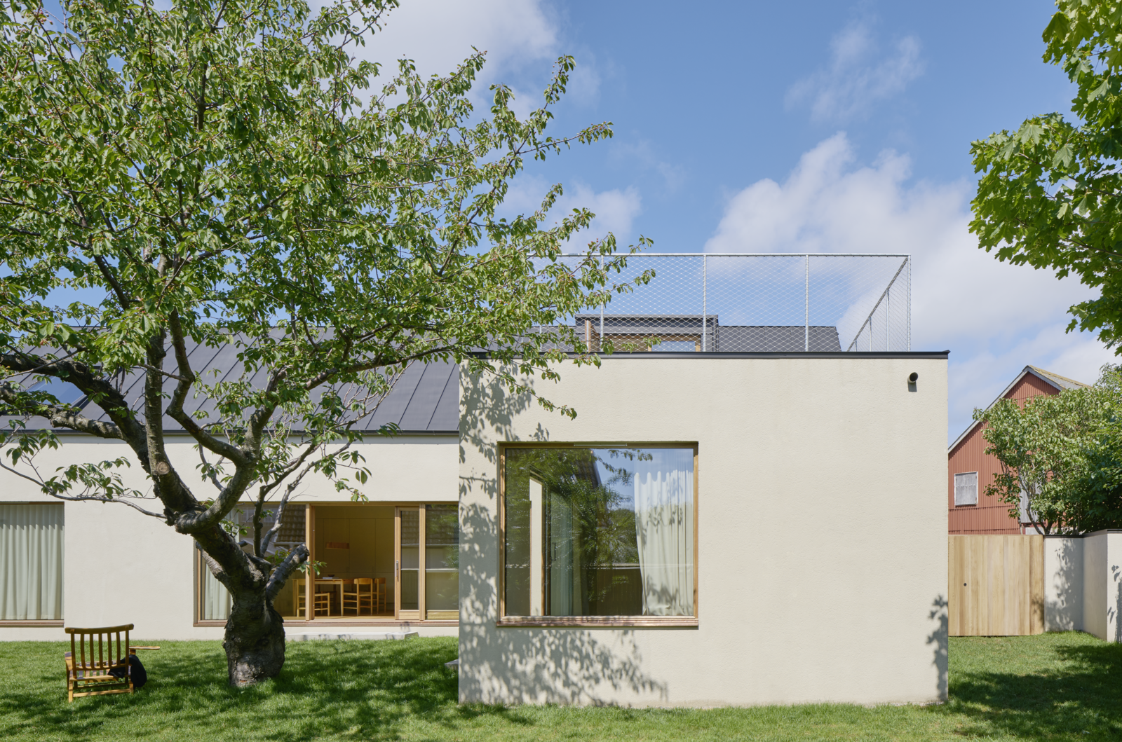 Tagged: Outdoor, Back Yard, Grass, and Trees.  Photo 3 of 12 in Sleek Scandinavian Design Permeates a Family's Summer House in an Old Fishing Village