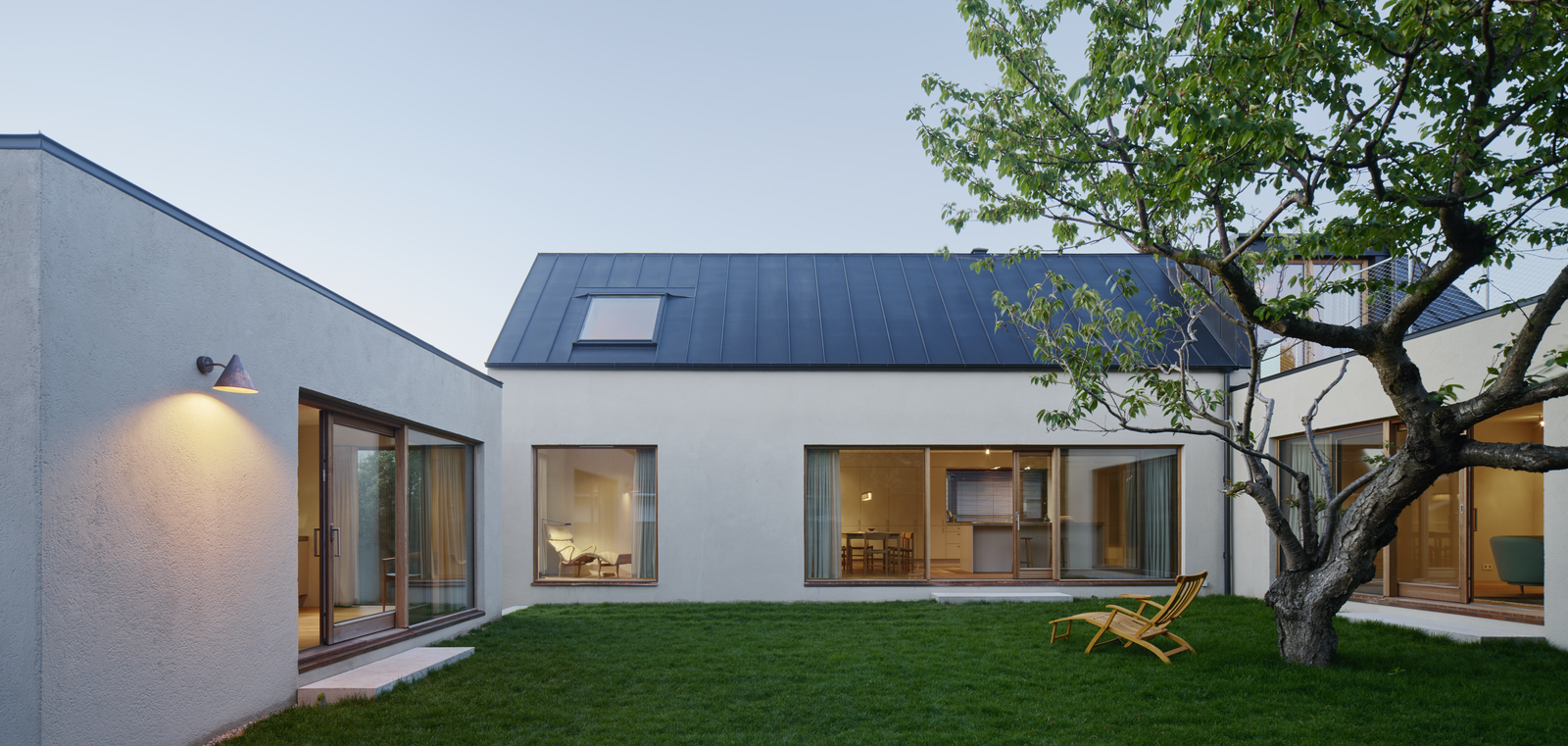 Tagged: Outdoor, Grass, and Back Yard.  Photo 1 of 12 in Sleek Scandinavian Design Permeates a Family's Summer House in an Old Fishing Village