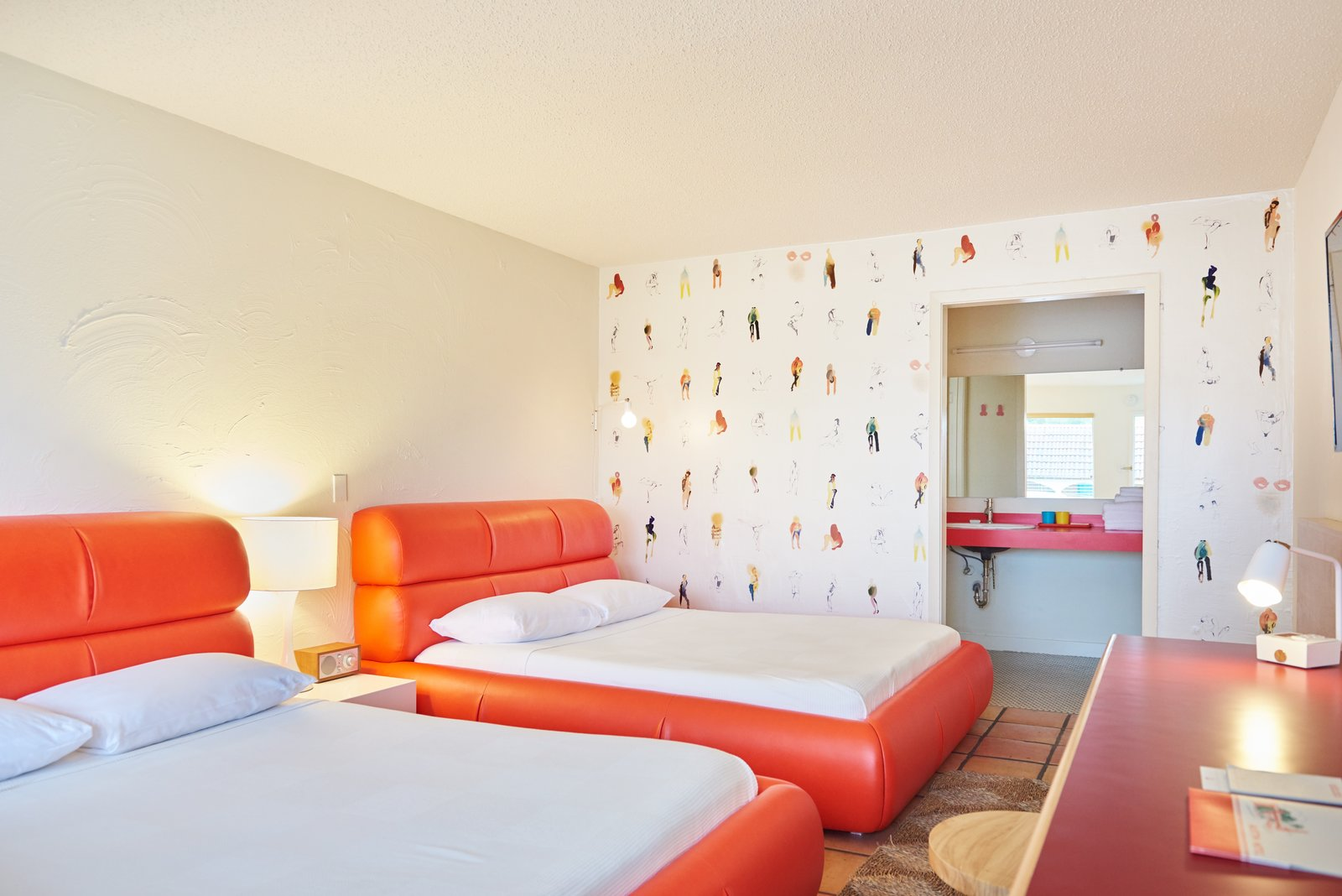 Tagged: Bedroom, Bed, Table Lighting, and Terra-cotta Tile Floor. The Rejuvenated Austin Motel Welcomes Guests With Upbeat, Midcentury-Modern Vibes - Photo 5 of 13