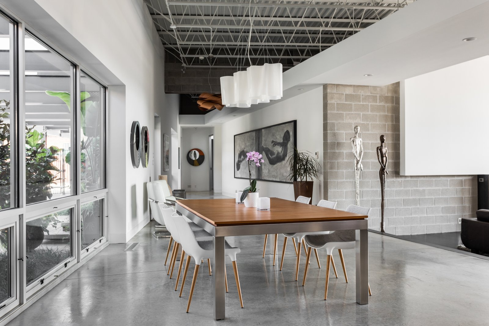 Tagged: Dining Room, Table, Chair, Accent Lighting, and Concrete Floor.  Photo 5 of 12 in A Converted Ink Factory in Downtown Indianapolis Asks $2.6M