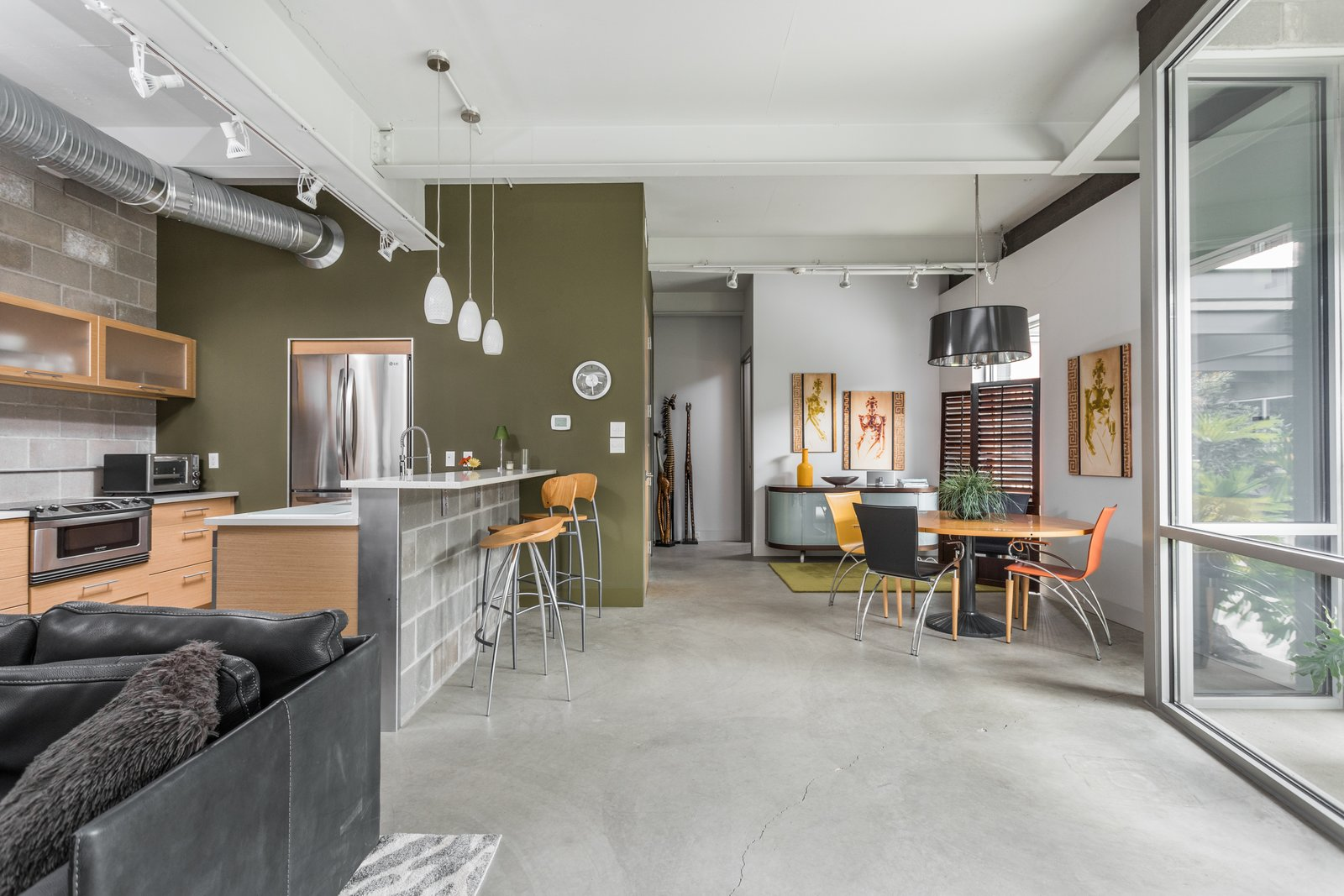 Tagged: Living Room, Chair, Pendant Lighting, and Concrete Floor.  Photo 12 of 12 in A Converted Ink Factory in Downtown Indianapolis Asks $2.6M