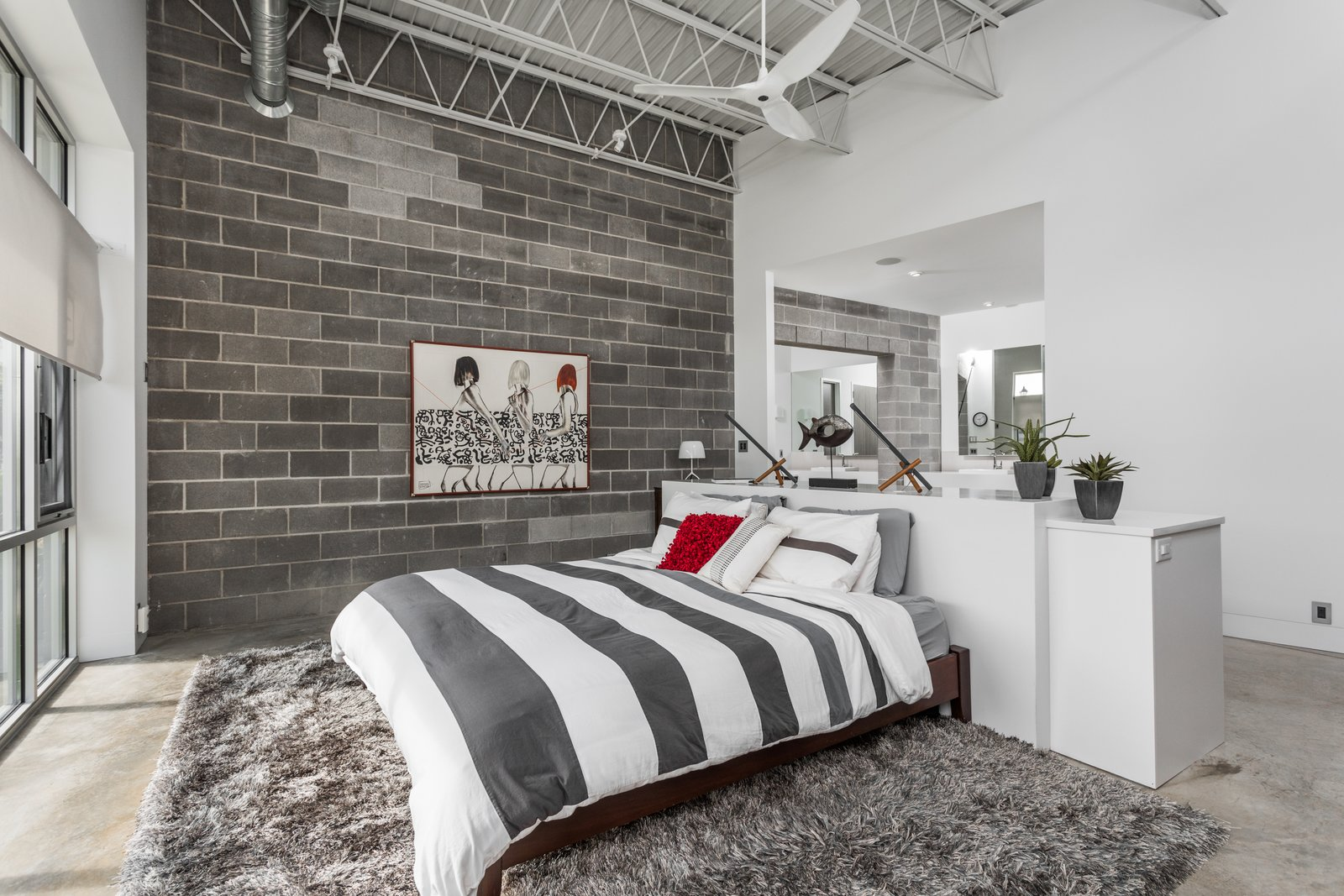 Tagged: Bedroom, Bed, and Concrete Floor.  Photo 10 of 12 in A Converted Ink Factory in Downtown Indianapolis Asks $2.6M