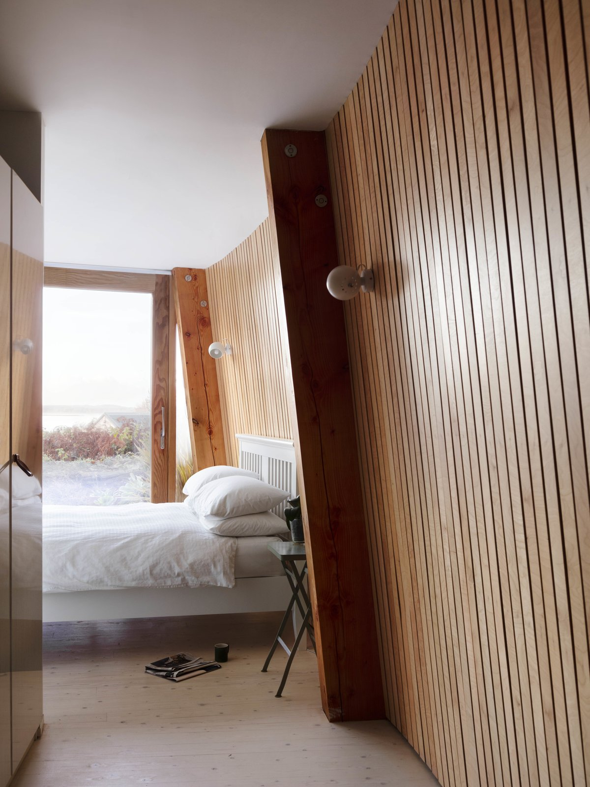 Tagged: Bedroom, Bed, Night Stands, Wall Lighting, and Light Hardwood Floor.  Photo 5 of 14 in Resembling the Inverted Hull of a Ship, an English Guest House Pays Homage to the Harbor