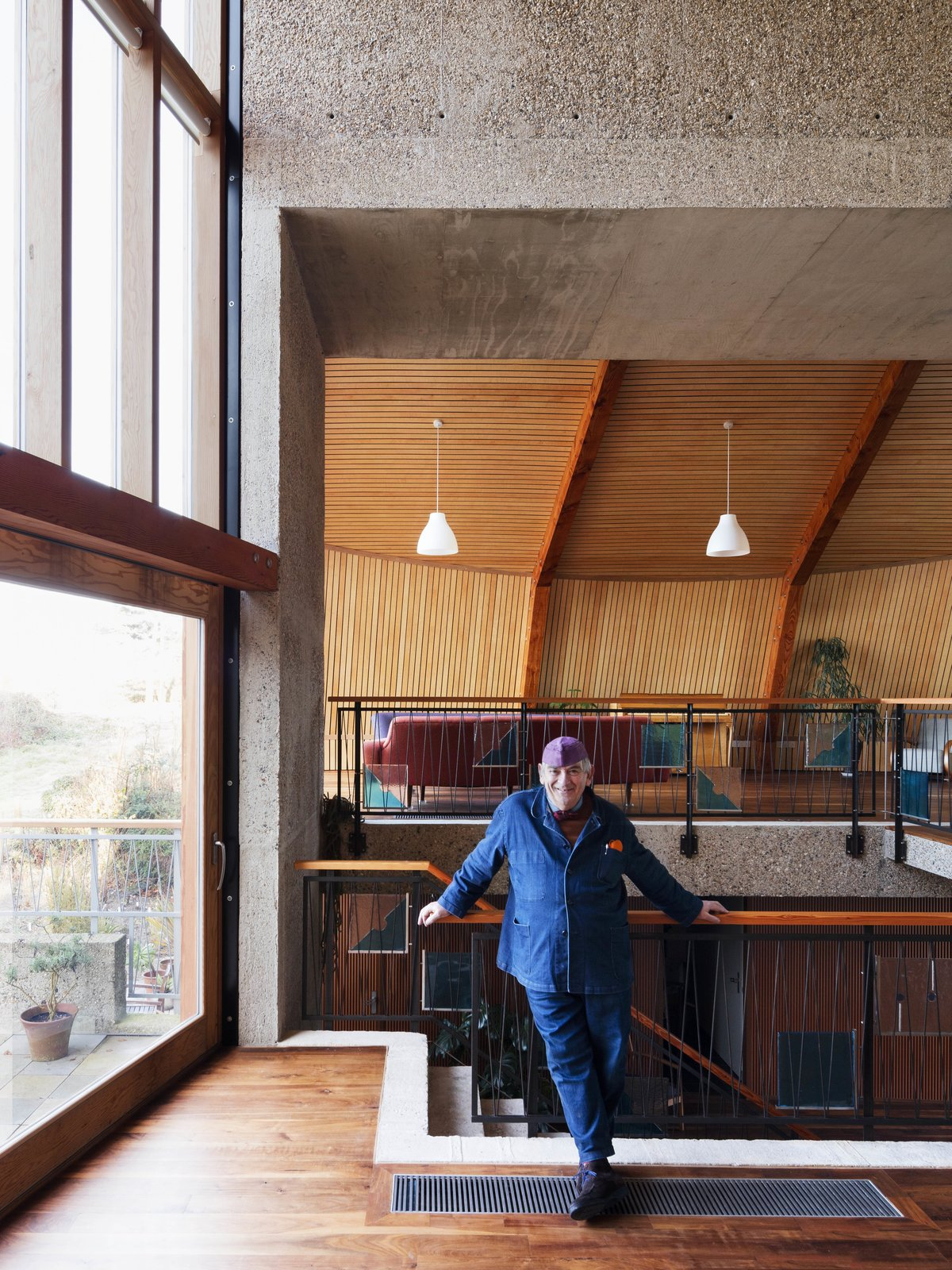 Tagged: Living Room, Dark Hardwood Floor, and Pendant Lighting.  Photo 10 of 14 in Resembling the Inverted Hull of a Ship, an English Guest House Pays Homage to the Harbor
