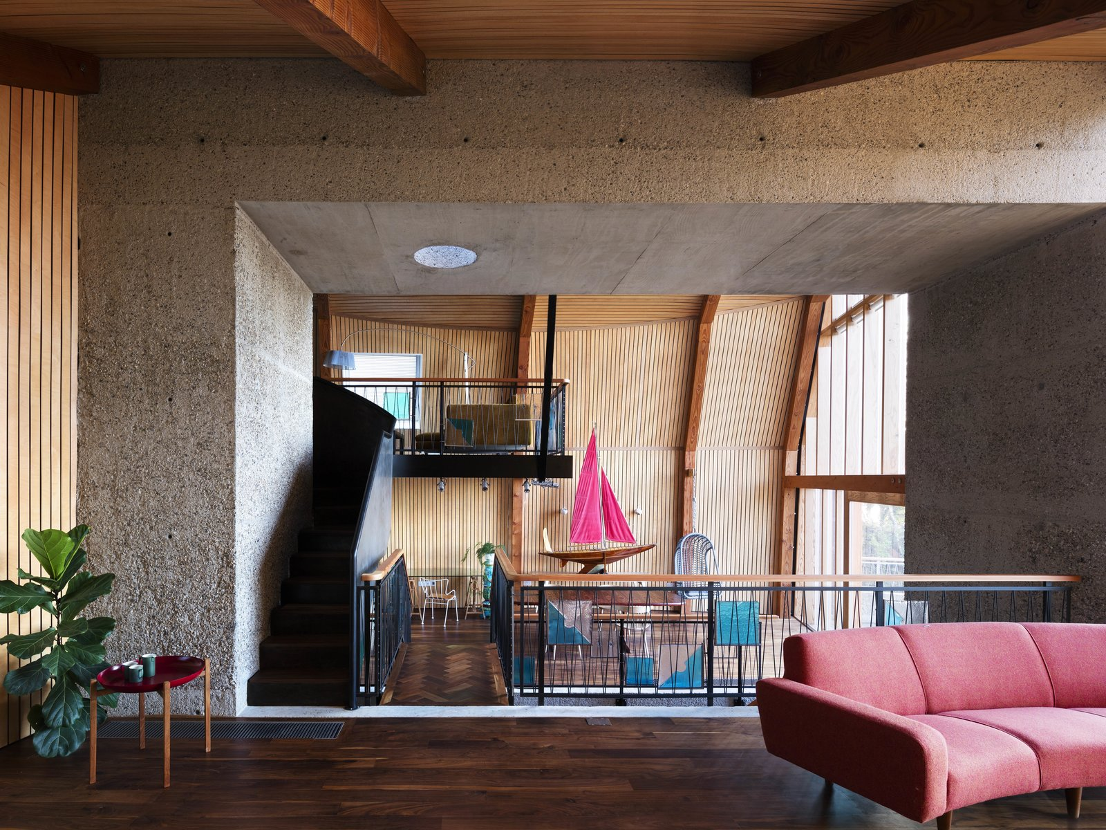 Tagged: Living Room, Sofa, and Dark Hardwood Floor.  Photo 9 of 14 in Resembling the Inverted Hull of a Ship, an English Guest House Pays Homage to the Harbor