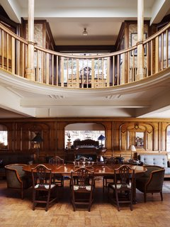 Resembling the Inverted Hull of a Ship, an English Guest House Pays Homage to the Harbor - Photo 3 of 13 - A circular gallery occupies the floor above the repurposed second-class lounge.