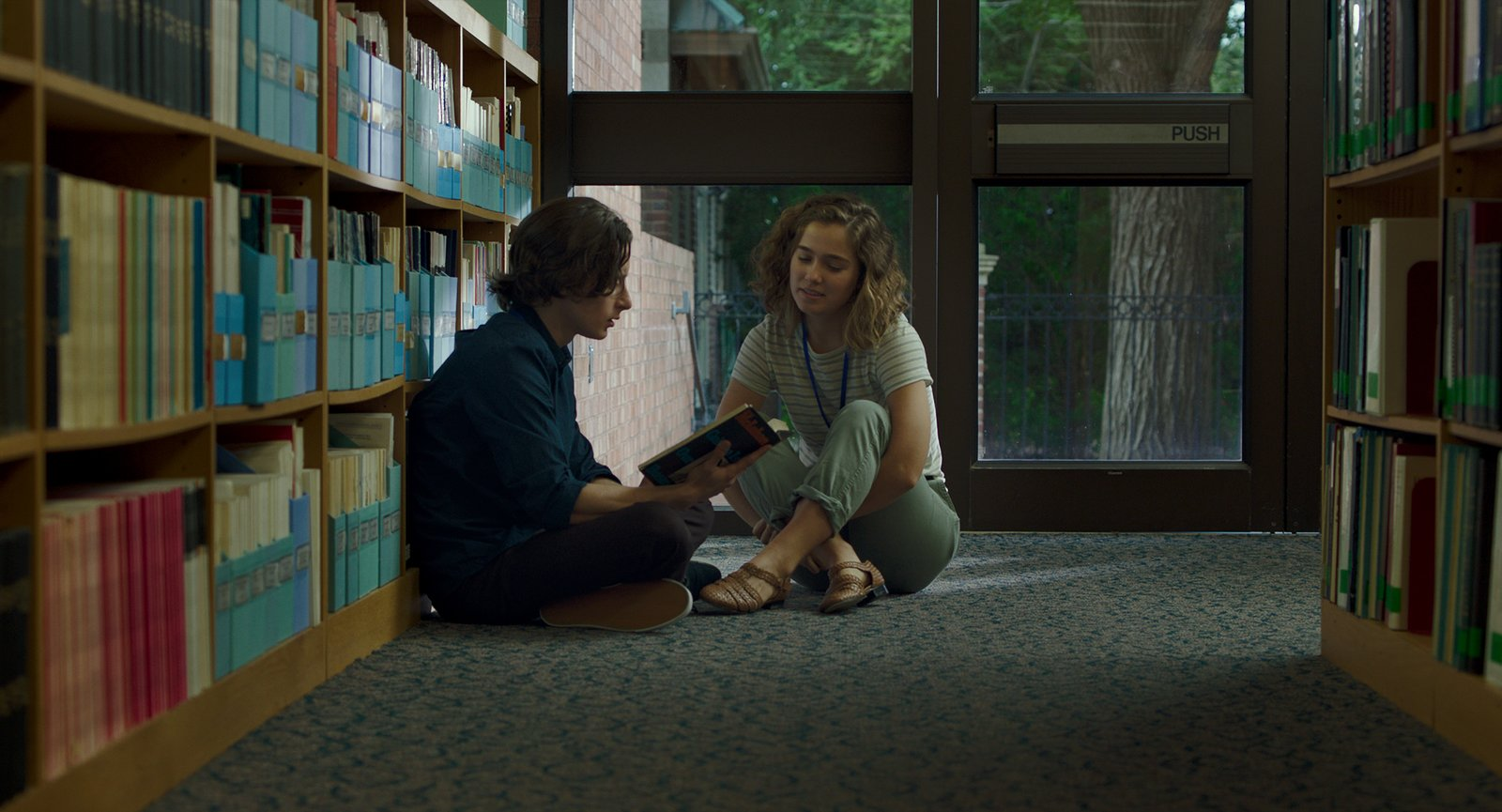 "Casey (Haley Lu Richardson) and Gabe (Rory Culkin) work at the Cleo Rogers Memorial Library designed by I.M. Pei. In the Indie Debut ""Columbus,"" Midcentury Architecture Stars Beside John Cho - Photo 3 of 8"