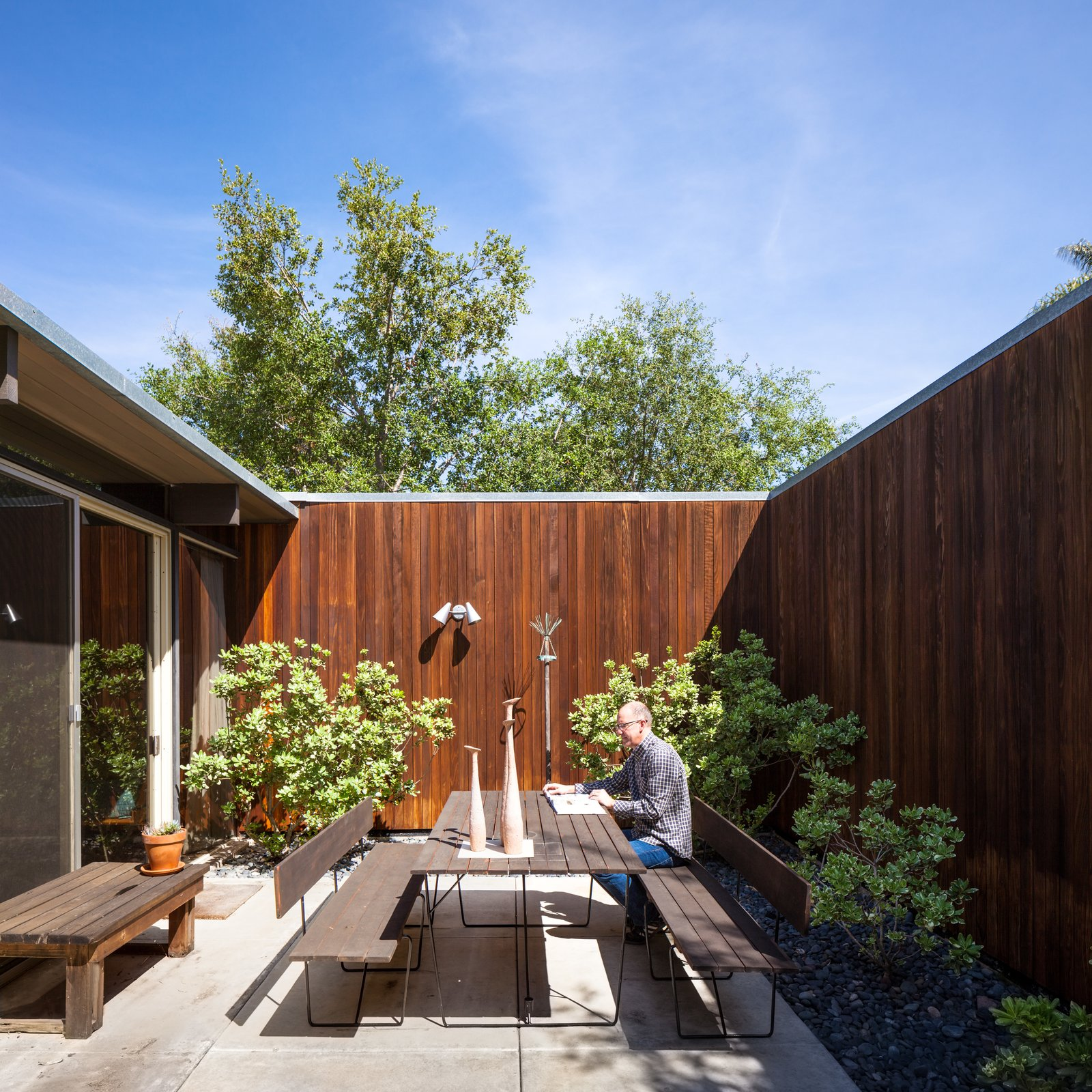 Tagged: Outdoor, Wood Fences, Wall, Concrete Patio, Porch, Deck, and Small Patio, Porch, Deck.  Photo 9 of 10 in A Stunningly Restored Midcentury by Case Study Architect Craig Ellwood Asks $800K in San Diego