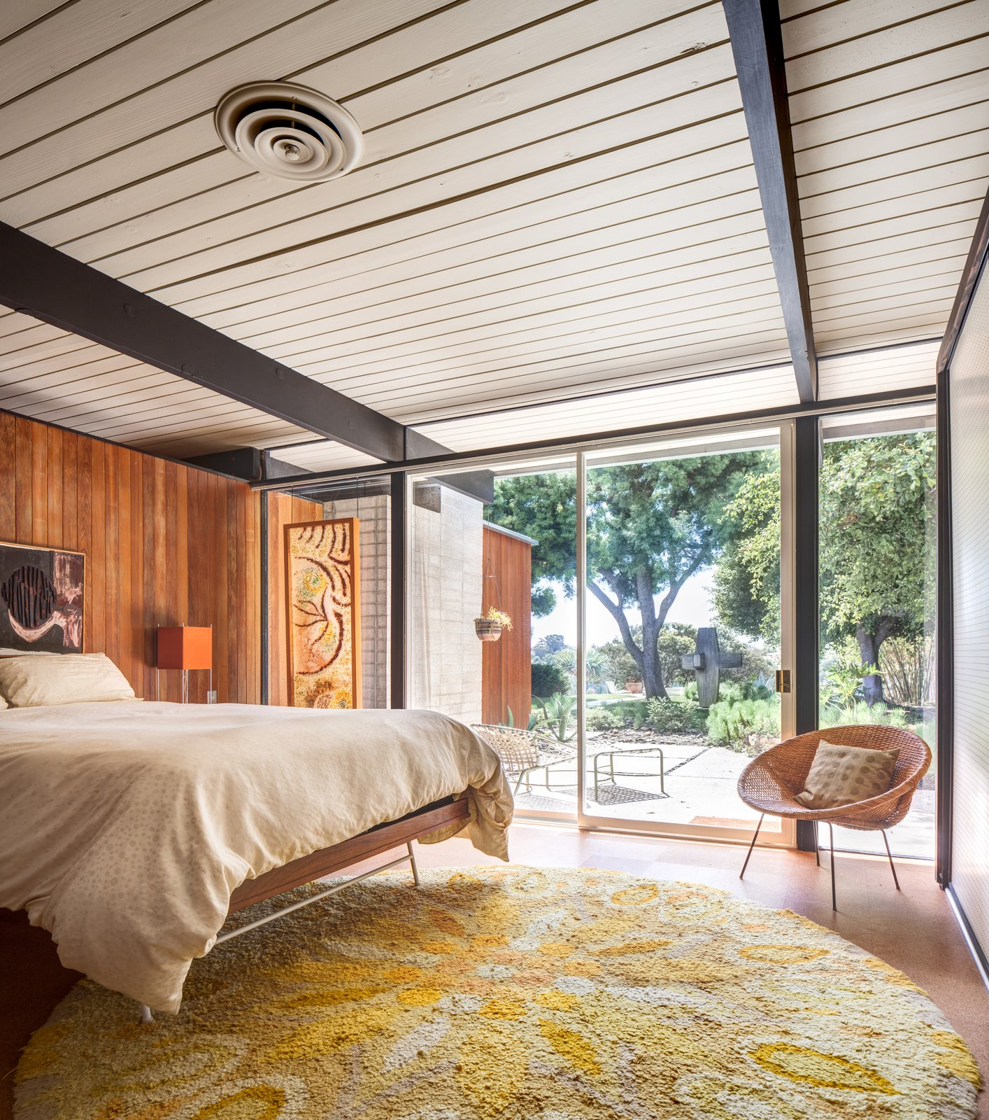 Tagged: Bedroom, Bed, Table Lighting, Chair, and Cork Floor.  Photo 7 of 10 in A Stunningly Restored Midcentury by Case Study Architect Craig Ellwood Asks $800K in San Diego