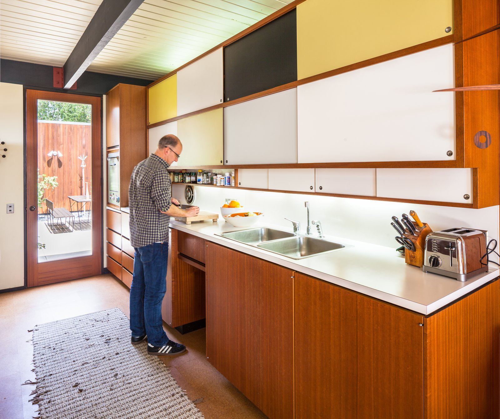 Tagged: Kitchen, Colorful Cabinet, Cork Floor, and Drop In Sink.  Photo 5 of 10 in A Stunningly Restored Midcentury by Case Study Architect Craig Ellwood Asks $800K in San Diego