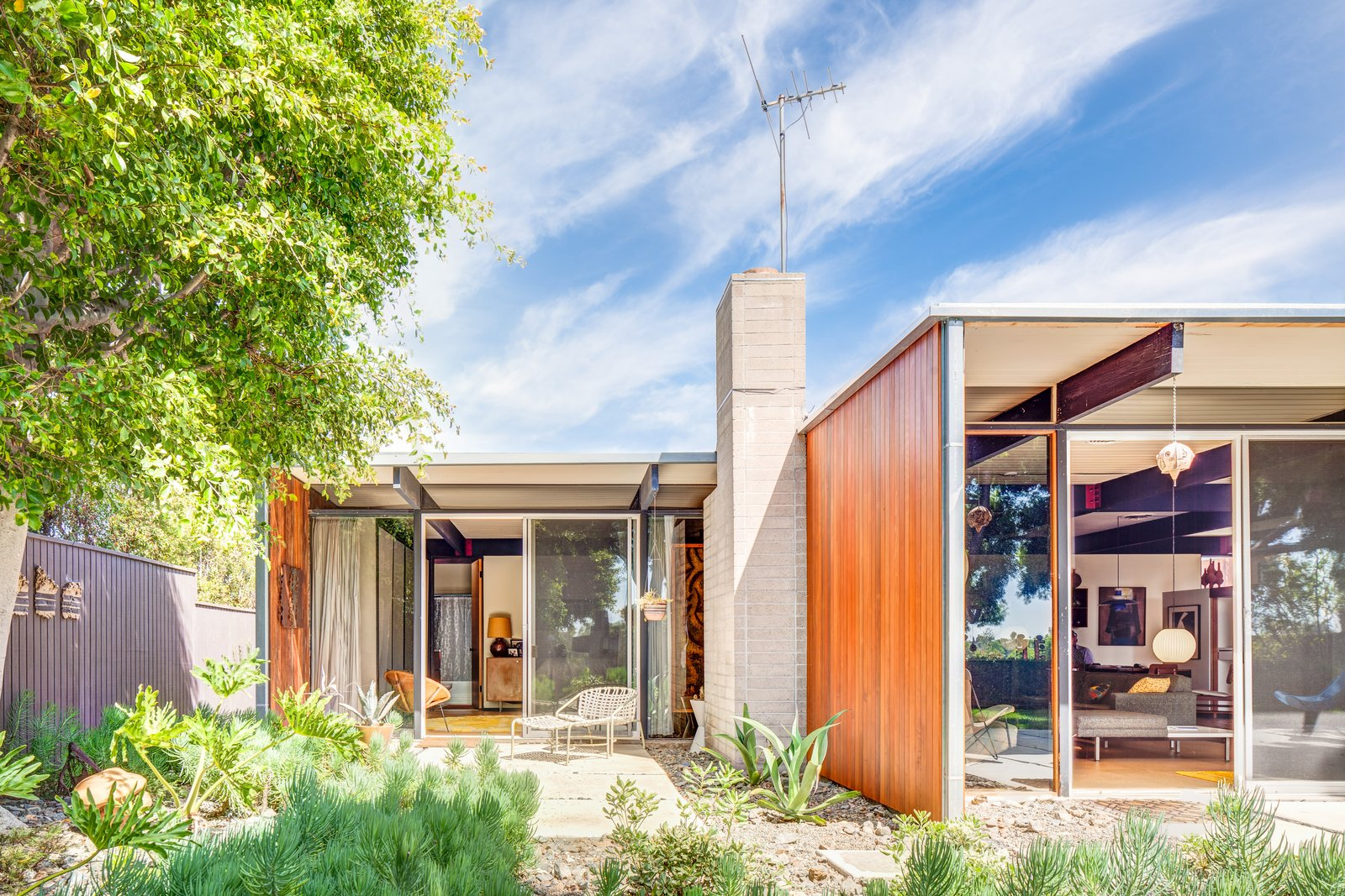 Tagged: Outdoor, Gardens, Small Patio, Porch, Deck, Back Yard, Concrete Patio, Porch, Deck, and Hardscapes. A Stunningly Restored Midcentury by Case Study Architect Craig Ellwood Asks $800K in San Diego - Photo 1 of 10