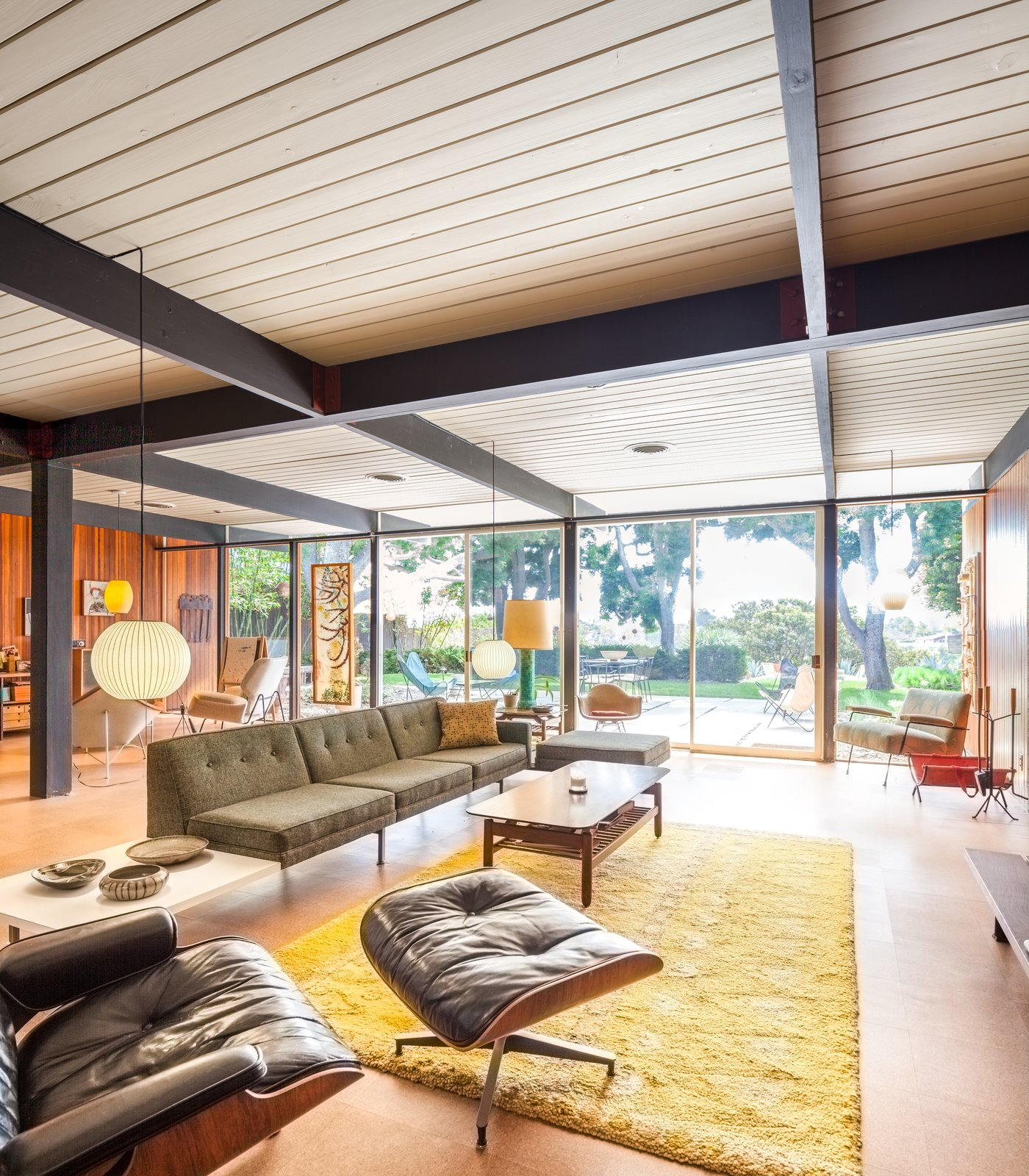 Tagged: Living Room, Sofa, End Tables, Coffee Tables, Pendant Lighting, and Cork Floor.  Photo 3 of 10 in A Stunningly Restored Midcentury by Case Study Architect Craig Ellwood Asks $800K in San Diego