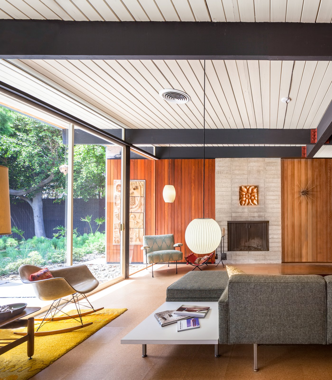 Tagged: Living Room, Sofa, End Tables, Chair, Pendant Lighting, Cork Floor, and Standard Layout Fireplace.  Photo 2 of 10 in A Stunningly Restored Midcentury by Case Study Architect Craig Ellwood Asks $800K in San Diego