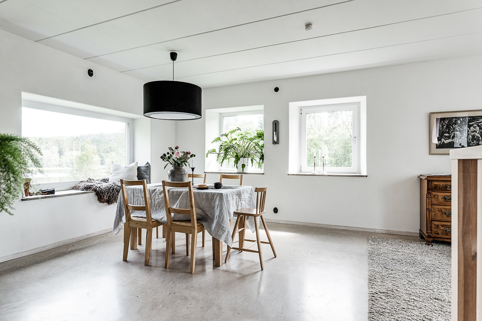 Tagged: Dining Room, Table, Chair, Pendant Lighting, and Concrete Floor.  Photo 4 of 12 in Make This Enchanting Swedish Greenhouse Your Home For $864K