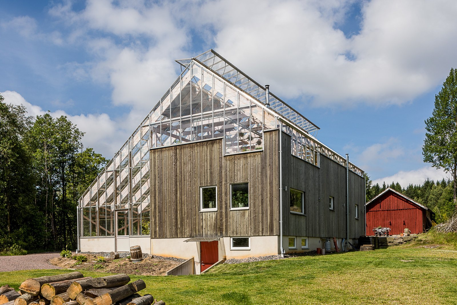 Tagged: Outdoor, Back Yard, Grass, and Trees.  Photo 10 of 12 in Make This Enchanting Swedish Greenhouse Your Home For $864K