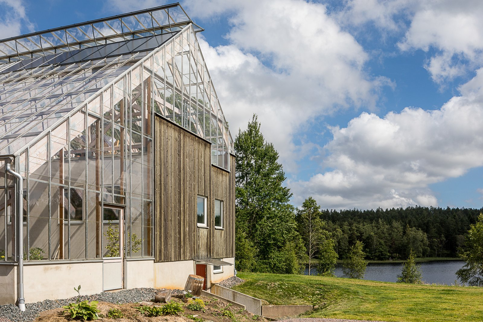 Tagged: Outdoor, Trees, Side Yard, and Grass.  Photo 11 of 12 in Make This Enchanting Swedish Greenhouse Your Home For $864K